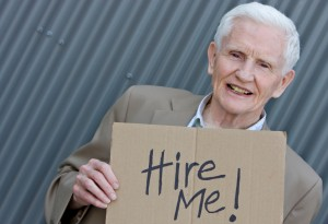 senior_worker_holding_sign
